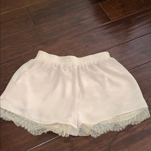 Cream shorts with lace detail